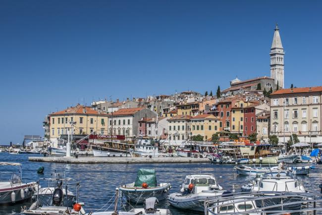 ports in the coast of Rovinj, Croatia with houses, boats in the sea.