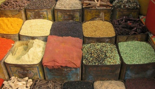 a spice market in india with colorful array of spices