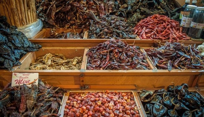 fresh spices at Oaxaca market in Mexico, different kinds of chillis