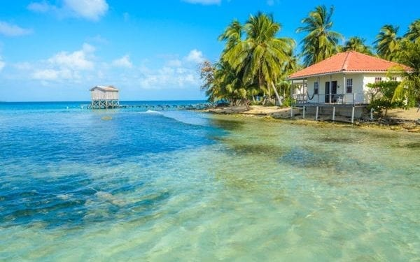 Beachside bungalows in Belize, one of the best places to enjoy a tropical climate
