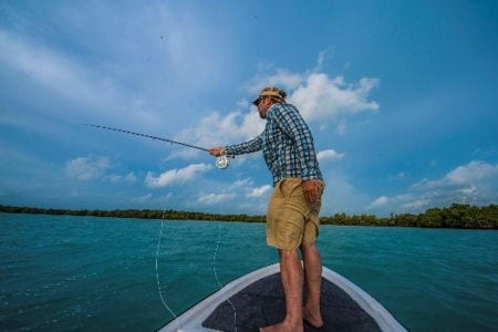 A man fly fishing in Belize