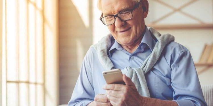 A senior man making a phone call
