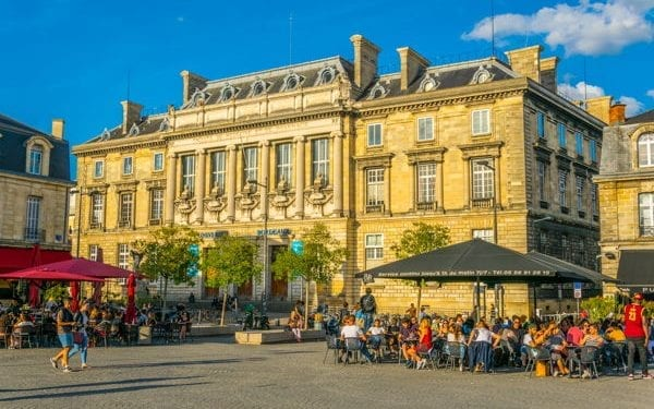 Bordeaux people enjoying food and drink in the sun. Bordeaux is one of the best places to buy real estate in france
