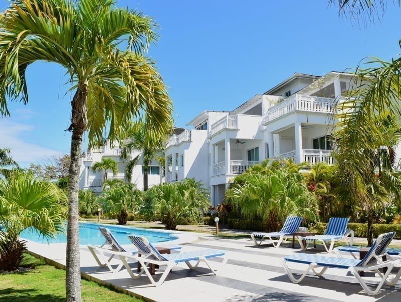 Holiday apartment with green vegetation and blue skies on background