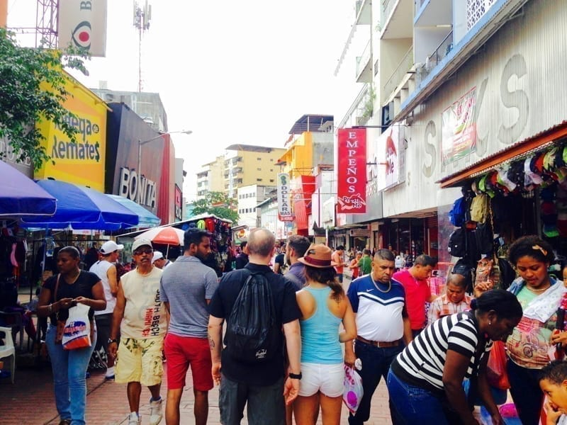 A city street in a popular market district is bustling in Panama City, Panama.