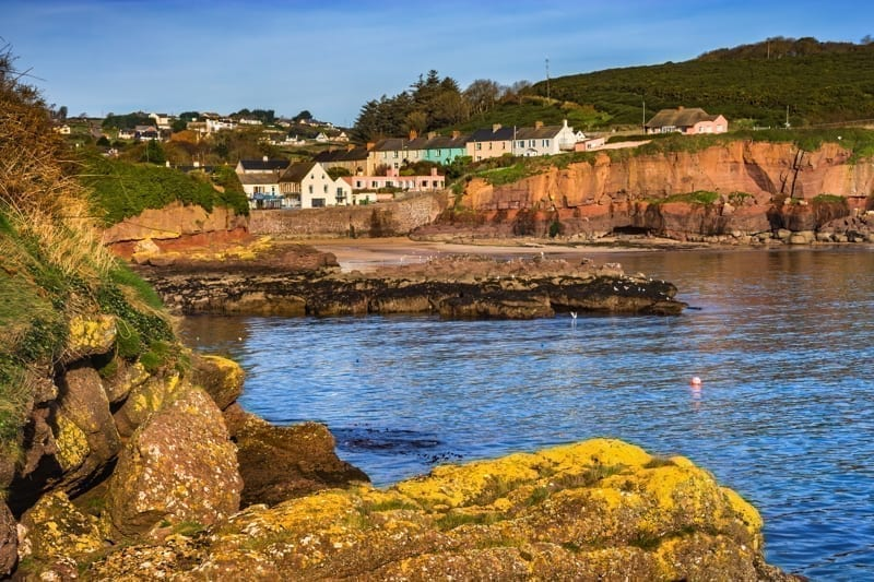 Town of Dunmore East and scenic sea coast in Ireland, County Waterford.