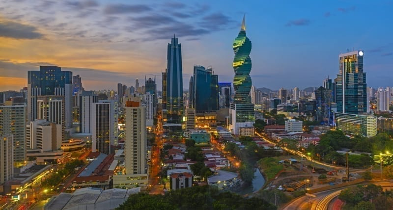 The colorful panoramic skyline of Panama City at sunset with high rise skyscrapers, Panama.