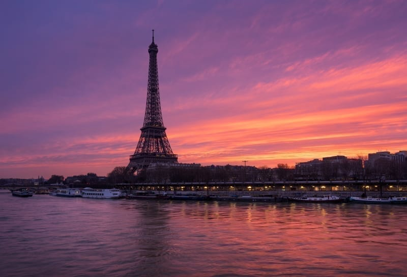 Fiery sunrise on the Eiffel Tower and Seine River, Paris.