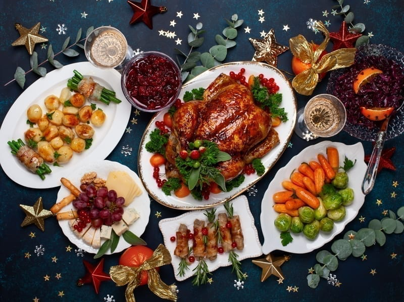 Christmas dinner with roasted chicken and various vegetables dishes.