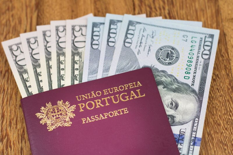 A Portugal passport with US dollars