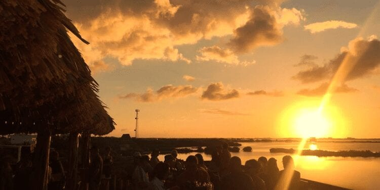 sunset at a bar in belize