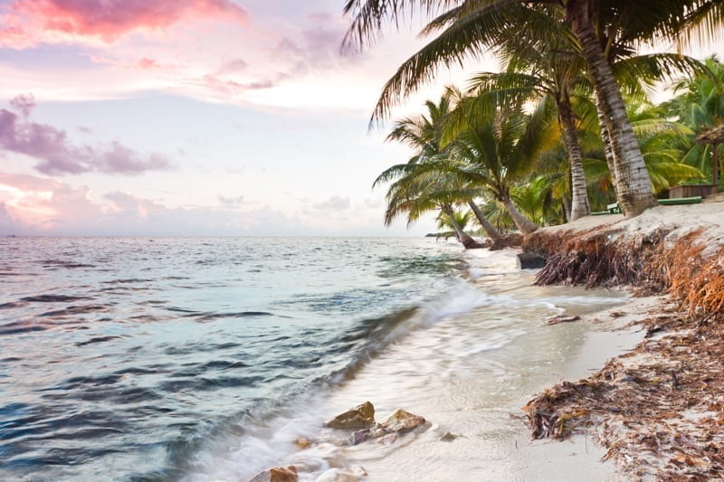 Beautiful tranquil beach sun rise in southern Belize.