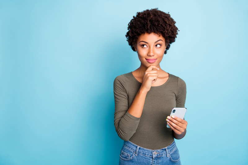 woman thinking about cell phone