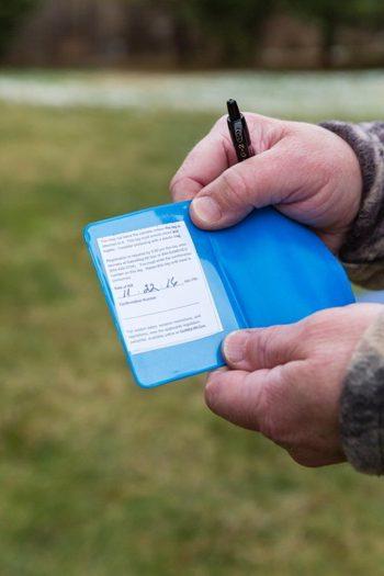 Deer hunter holding his completed deer license