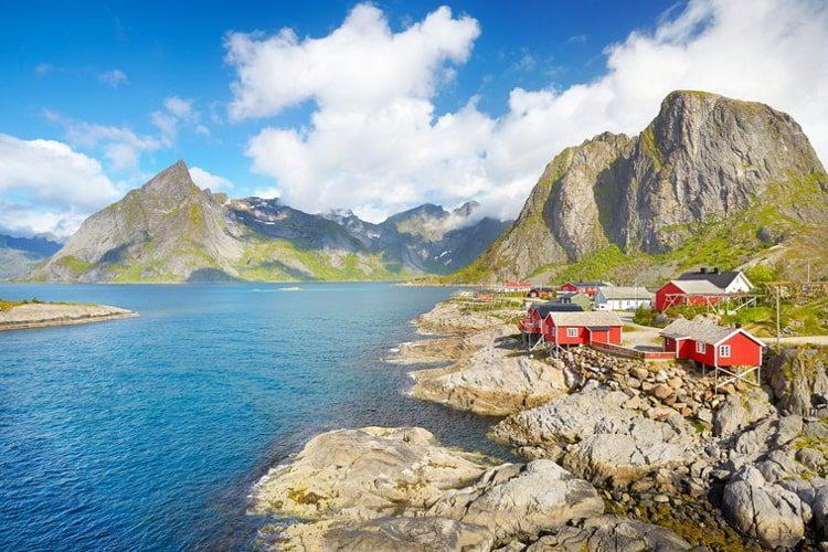 Traditional red wooden fishermen`s huts rorbu, Lofoten Island landscape, Norway
