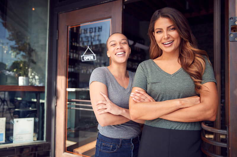 franchise owners with a new business coffee shop