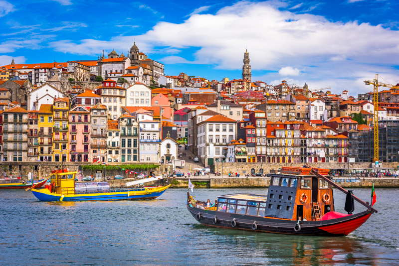 Porto river with boats and city in the background