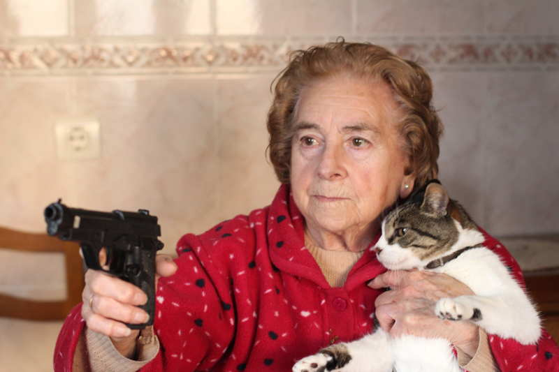 lady with gun protecting her cat