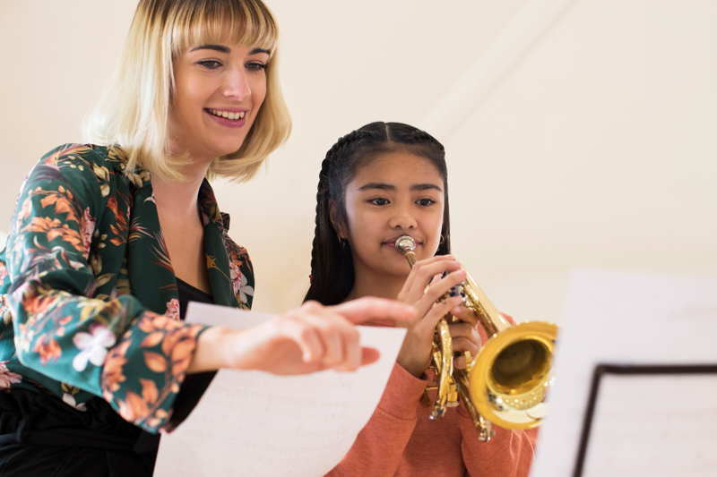 lady teaching music to a student