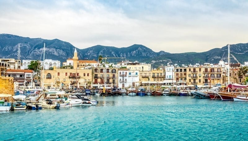Kirenia historical city center, view to marina with many yachts and boats and mountains in the background, North Cyprus.