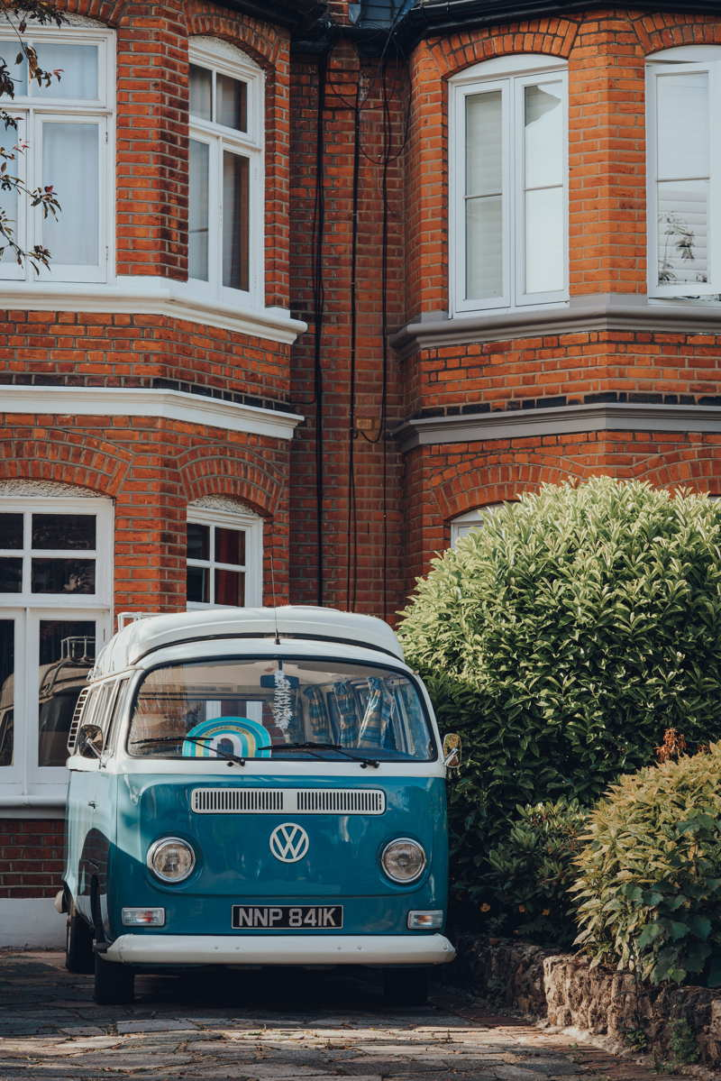 vw camper van parked on drive outside house