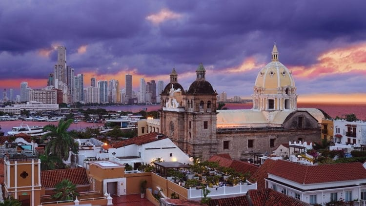 View from the walled city looking at the Church of St Peter Claver and the modern skyscrapers of Boca Grande in the background in Cartagena, Colombia.
