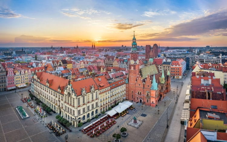 Aerial view of Rynek square, Poland with historic gothic Town Hall on sunrise.