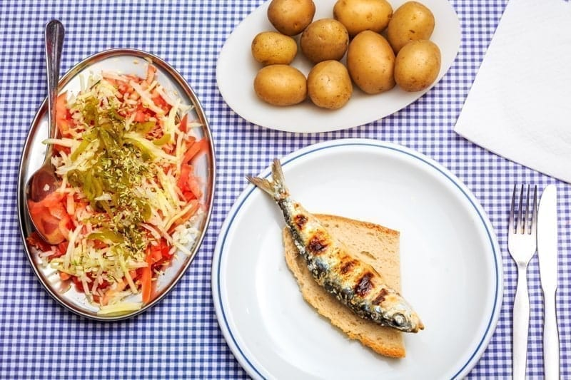 Grilled sardines with salad, bread and potato, Portugal.