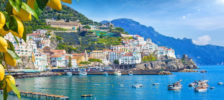 Panoramic view of beautiful Amalfi on hills leading down to coast, Campania, Italy.