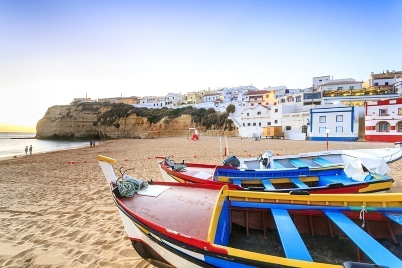 Beautiful beach with boats in Carvoeiro, Algarve, Portugal.