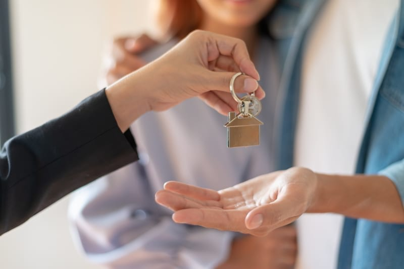 Couple receiving new apartment key.