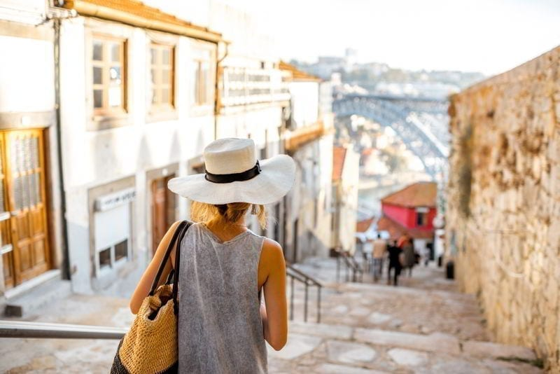 Young woman tourist walking in Porto city, Portugal