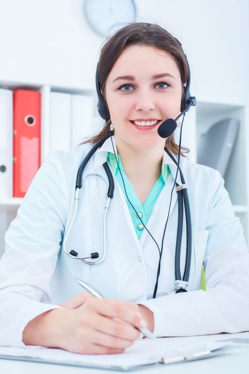 Call center operator woman in medical clinic.