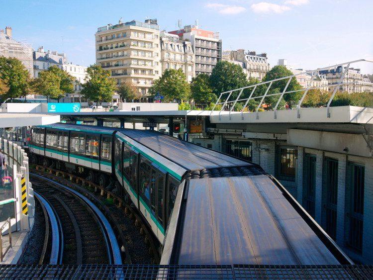 Paris Metro train stopping at Bastille Station