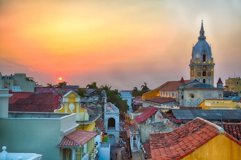 View over the rooftops of the old city of Cartagena, Colombia during a vibrant sunset