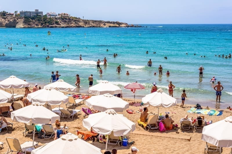 Tourists and locals enjoying a nice summer day at the Coral Bay Beach, Cyprus.