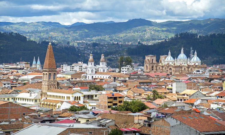 View of the city of Cuenca, Ecuador, with its many churches and rooftops, on a cloudy day