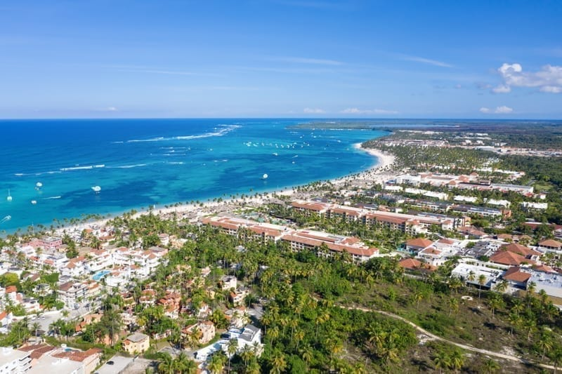 Aerial view from drone on Caribbean sea coastline with resorts. Dominican Republic