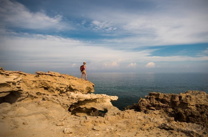 Hiker enjoying view of a Blue Lagoon near Polis city, Cyprus.