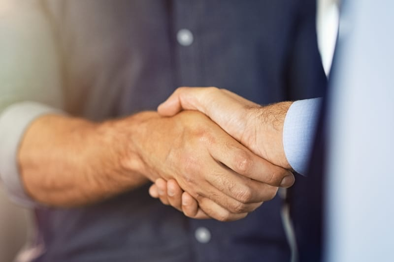 Close up of friendly handshake