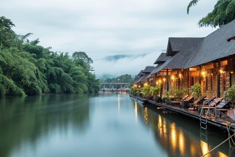 Resort wooden house floating and mountain fog on river Kwai At Sai Yok, Kanchanaburi, Thailand