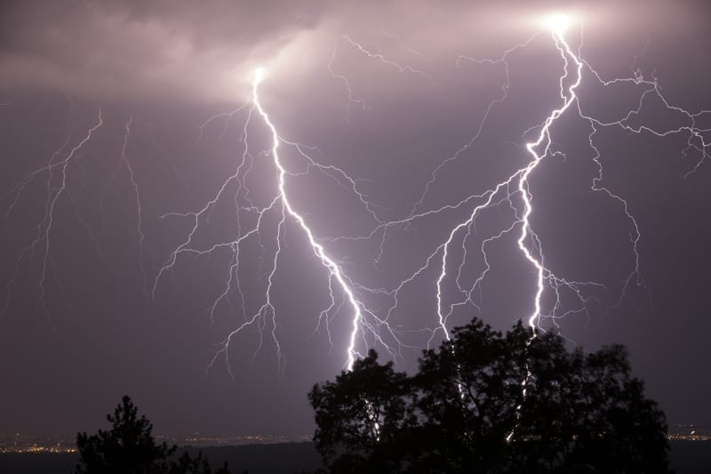 Night shot of stunning lightning strikes over non-urban landscape.