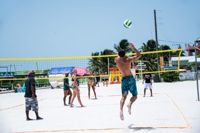 A game of pickup beach volleyball on the island of Caye Caulker, Belize.