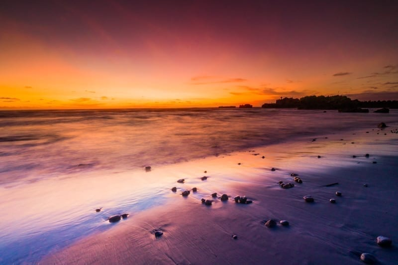 Clear orange & purple sky from golden hours of Mengening Beach Sunset at Canggu Bali.