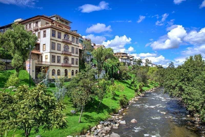 Tomebamba river with beautiful houses and architecture, in Cuenca, Ecuador