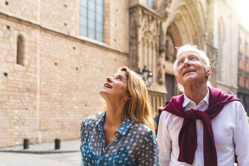 Senior couple visiting the old town in Barcelona.