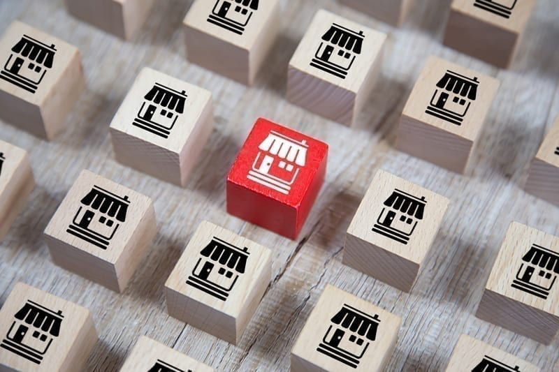 Wooden cube Stacked with Franchise business marketing icons