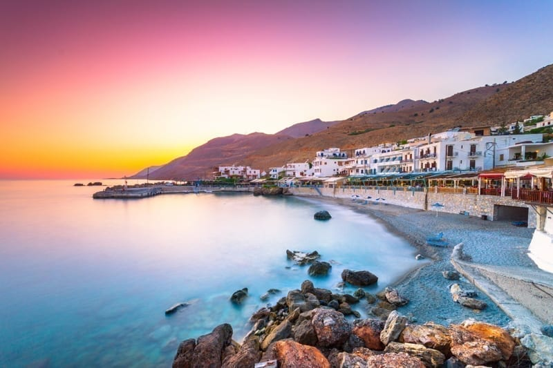 Beautiful sunrise with orange and pink colors in a small traditional village in Chania, Crete, Greece