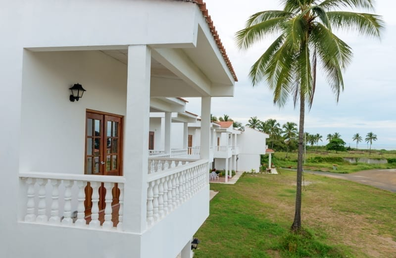 Scenic view overlooking luxury villas and calm blue sky and Pacific ocean in Panama.