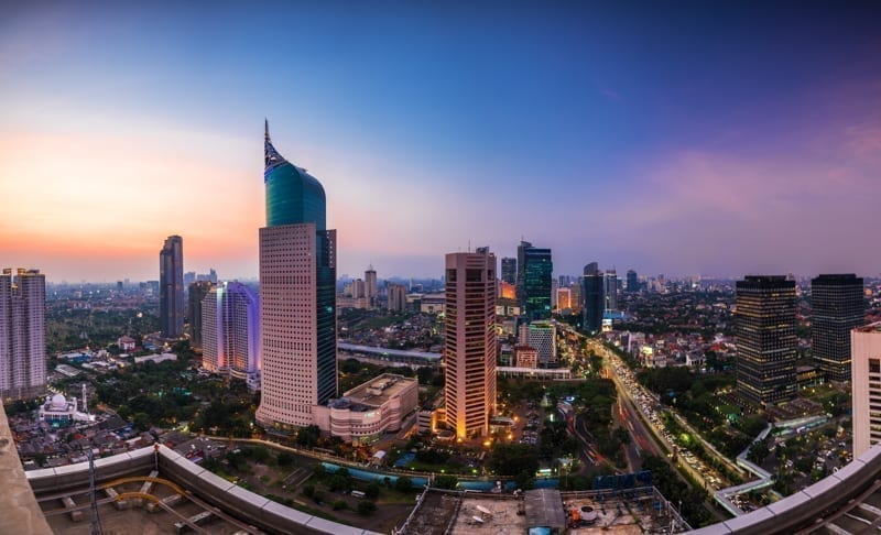 Colorful Jakarta Skyline at dawn with the iconic building. The building is one of the highest building in Indonesia.